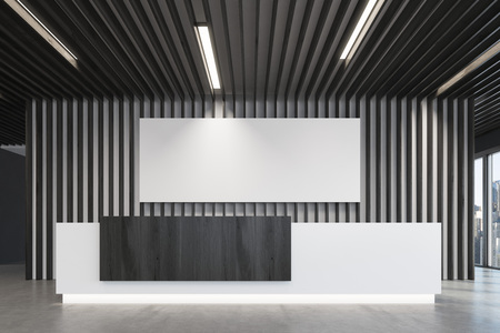 Close up of a white and black reception counter is standing in a black office lobby with wooden decoration elements and a long horizontal poster. Panoramic window. Empty hall. 3d rendering, mock up