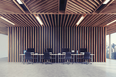 Open space office interior with wooden walls, panoramic windows and a row of tables standing along the wall. Blank computer monitors. 3d rendering mock up toned image
