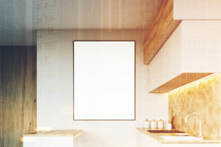 countertop: Light wood kitchen interior close up with a counter top, a sink and many closets. A framed poster on the wall. 3d rendering mock up toned image Stock Photo