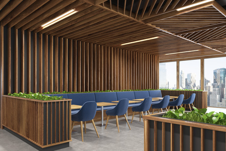 Side view of a modern cafe or a coffee shop interior with wooden walls, panoramic windows and dark blue armchairs standing near square wooden tables. 3d rendering mock up