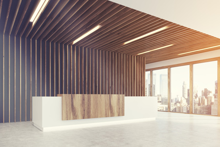 Side view of a white and light wooden reception counter is standing in a light colored office lobby with wooden decoration elements. Panoramic window. Empty hall. 3d rendering mock up toned imge