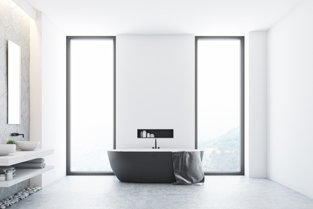 White modern bathroom interior with a gray tub standing near a window, a large towel hanging on its side and a shelf with cleaning products in the wall. 3d rendering, mock up