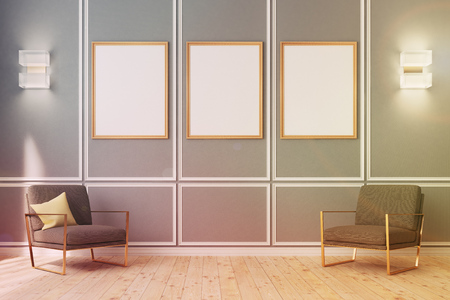 Three framed vertical posters are hanging on a gray wall in an empty room with wooden floor and modern wall lamps and armchairs. 3d rendering, mock up, toned image