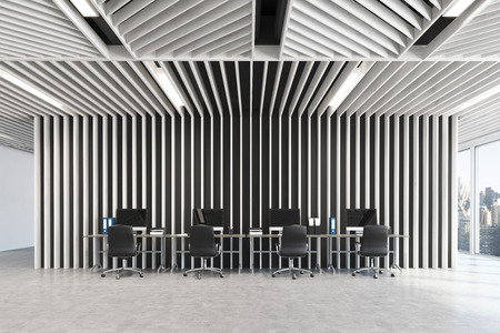 Open space office interior with gray wooden walls, panoramic windows and a row of tables standing along the wall. Blank computer monitors. 3d rendering mock up