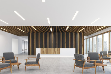 Corner of a white and light wooden reception counter is standing in a black office lobby with wooden decoration elements. Armchairs in an empty hall. 3d rendering, mock up