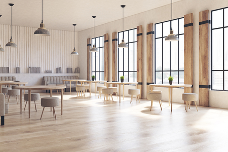 Side view of a modern cafe interior with concrete walls and floor, wooden shutters at tall windows and round tables with chairs. 3d rendering mock up Foto de archivo
