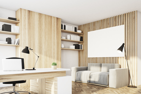 ceo: Corner of an office with light wooden walls, a desk with a laptop, a gray sofa, bookshelves and a poster. 3d rendering, mock up