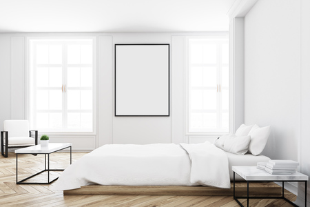 View of a white bedroom interior with a double bed, a coffee table, a blank wall and a vertical picture on it. 3d rendering mock up Banco de Imagens