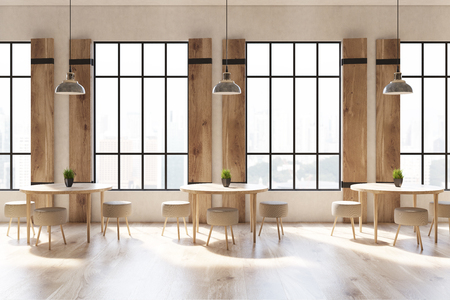 Close up of a modern cafe interior with concrete walls and floor, wooden shutters at tall windows and round tables with chairs. 3d rendering mock up