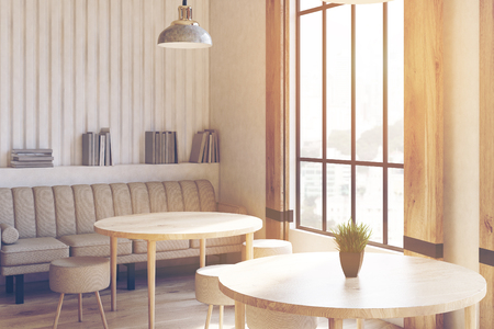 round chairs: Corner of a modern cafe interior with concrete walls and floor, wooden shutters at tall windows and round tables with chairs. 3d rendering mock up toned image