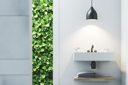 silver: Eco bathroom interior with a narrow window, green shrubbery is seen through it. There is a sink hanging on a marble wall. 3d rendering mock up Stock Photo