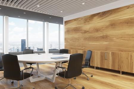 round chairs: Corner of a dark wooden wall decoration and a large round meeting room table. 3d rendering mock up