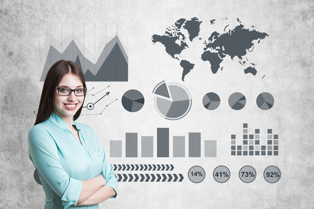 Image of businesswoman in grey suit drawing graph Stock Photo