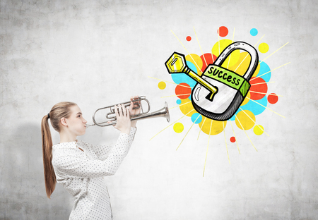 Side view of a blond woman with a trumpet standing near a concrete wall with a key to success sketch Stock Photo