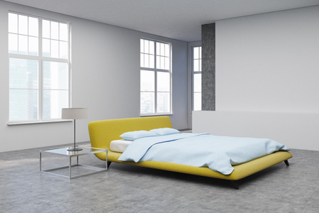 Bedroom interior with a yellow double bed standing in the center of a room with concrete floor. Glass bedside table with a lamp. Rectangular poster. Corner. 3d rendering mock up
