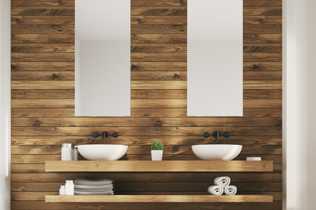 of them: Close up of two white sinks standing on a wooden shelf. There are two narrow vertical posters above them. 3d rendering mock up Stock Photo