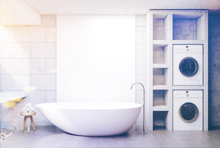 bathe: Modern bathroom interior with concrete walls and floor, a sink, a white tub and two washing machines. A chair with rolled towels. 3d rendering mock up toned image