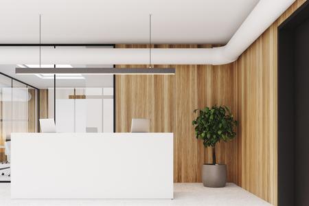 Interior de oficina de pared de madera con piso de concreto, paredes de vidrio, un árbol en una maceta y un mostrador de recepción blanco con computadoras portátiles. Representación 3d simular Foto de archivo