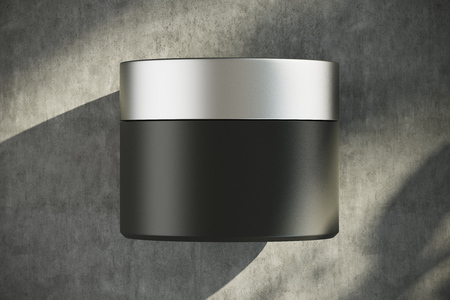 suntan lotion: Black cream container with a silver lid. Shadows. Concrete background. Concept of health and beauty. 3d rendering mock up Stock Photo
