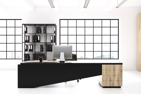 ceo: CEO office interior with an original table, a computer standing on it, a bookcase with black binders and loft windows. 3d rendering mock up Stock Photo