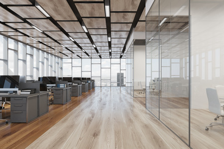Open space office interior with a wooden floor, a glass wall, a rectangular ceiling pattern and panoramic windows. Computers on desks. Front 3d rendering mock up