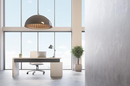 Loft CEO kantoor met een grijze muur, panoramische ramen, een moderne computertafel met een laptop en een lamp erop. Een boom in een pot. 3D-rendering mock up