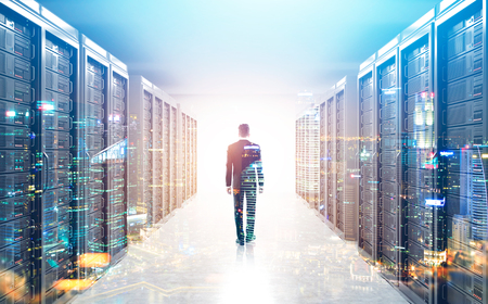 Rear view of an engineer standing in a server room with a cityscape in the foreground. 3d rendering mock up toned image double exposure Standard-Bild