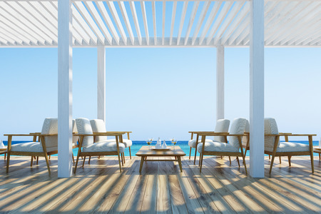 cloudless: White armchairs standing near wooden tables in an outdoors cafe with a wooden ceiling and floor. Seaside with a cloudless sky. 3d rendering mock up