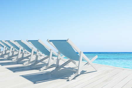 pier: Row of blue and wooden deck chairs standing on a wooden pier near an ocean. Cloudless sky. 3d rendering mock up Stock Photo