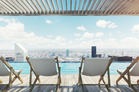 Four white and wooden deck chairs standing on a pier. Cityscape with a beautiful sky with clouds. 3d rendering mock up Stock Photo