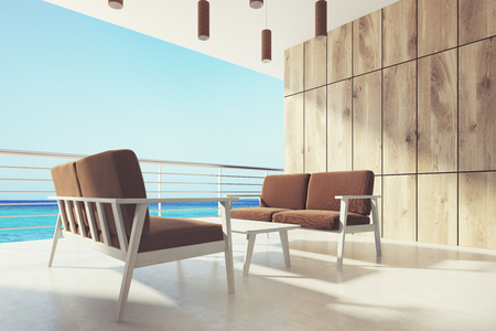 overlook: Wooden balcony with brown armchairs Stock Photo