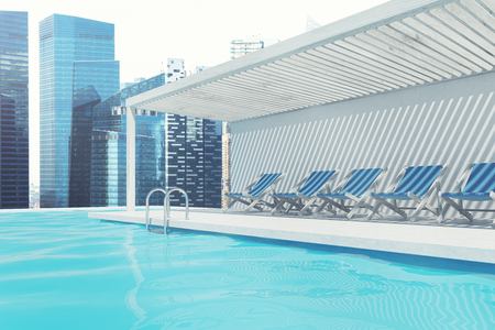 Row of blue deck chairs standing along a swimming pool. A magnificent cityscape in the background. 3d rendering mock up Stock Photo