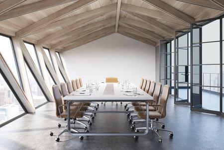 Attic conference room interior with a long table, rows of white chairs near it and glass doors. 3d rendering mock up Stock Photo