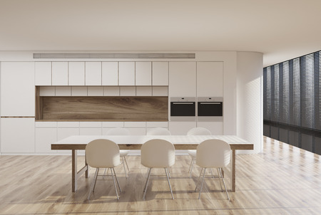countertop: White kitchen interior with a panoramic window, shades, a long table with white chairs around it, a countertop and two built in stoves. Front view. 3d rendering mock up
