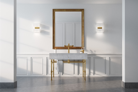 Vintage bathroom interior with a white sink, gold legs and a white wall with a framed mirror. Concept of luxury and wealth. 3d rendering Banco de Imagens