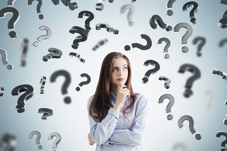 Young businesswoman in a blue shirt wearing a dark red lipstick is standing near a gray wall with question marks falling around him. Mock up