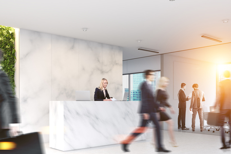 Business people walking in a marble office lobby with a reception table and glass wall rooms in the background. 3d rendering mock up toned image Фото со стока