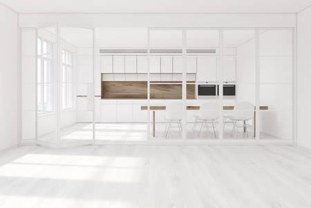 White kitchen interior with a wooden floor, white walls, glass doors and a long dining table with white chairs around it and white cupboards with built in ovens. 3d rendering mock up