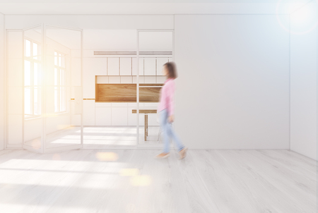 White kitchen interior with a wooden floor, white walls, glass doors and a long dining table with white chairs around it and a white wall fragment. Woman. 3d rendering mock up toned image Stock Photo