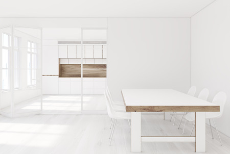 White dining room interior with a long wooden table, two rows of white chairs and a kitchen in the background. 3d rendering mock up Stock Photo