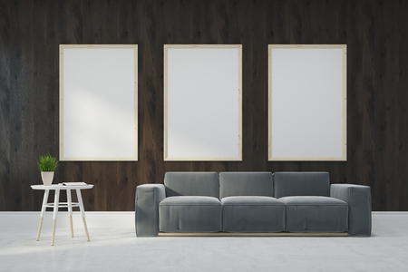 modern living room: Wooden living room interior with a conccrete floor, wooden walls, loft windows and a gray sofa. Three posters. 3d rendering mock up