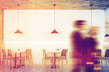 interior decoration: People in white cafe interior with a wooden wall and a ceiling, a geometric floor pattern, square tables and gray chairs near them. Low hangings lamps. 3d rendering mock up toned image double exposure Stock Photo