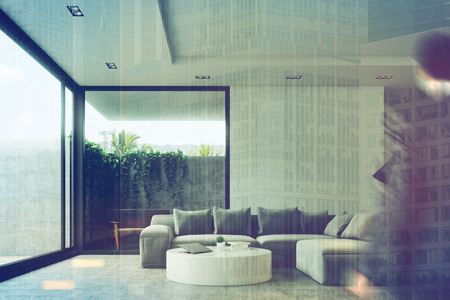 couch: Businessman ini a living room interior with a concrete floor, a gray sofa, a round table and a loft window. Front view. 3d rendering mock up Stock Photo