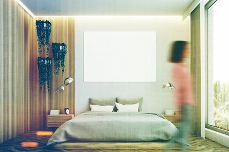 master: Gray and wooden bedroom interior with a wooden floor, a gray bed and a large horizontal poster hanging above it. Woman. 3d rendering mock up toned image double exposure