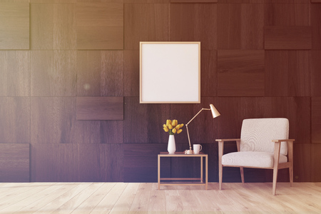 modern living room: Living room interior with dark wooden walls, a white armchair, a coffee table and a framed square poster. 3d rendering mock up toned image Stock Photo