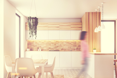 kitchen cabinets: Hexagon pattern kitchen wall with white countertops, a white and wooden bar and a table with white chairs standing around it. Woman 3d rendering mock up toned image
