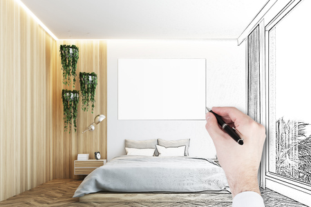 Man s hand drawing a gray and wooden bedroom interior with a wooden floor, a gray bed and a large horizontal poster hanging above it. 3d rendering mock up Stock Photo