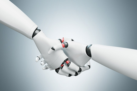 greet: Close up of two white cyborgs shaking hands. Gray background. Concept of the future and new technologies. Side view. 3d rendering mock up Stock Photo