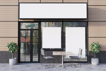 Beige cafe exterior with a glass door, a place for a name and two different shape posters in windows. 3d rendering mock up
