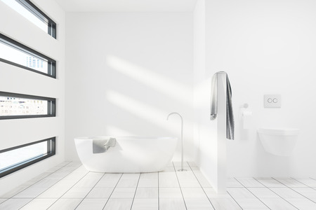 bathroom interior: Luxury white bathroom interior with a white tub, a toilet, a gray towel and an originally shaped window. 3d rendering mock up Stock Photo